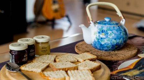 Toasted bread, jams and a pot of green tea.